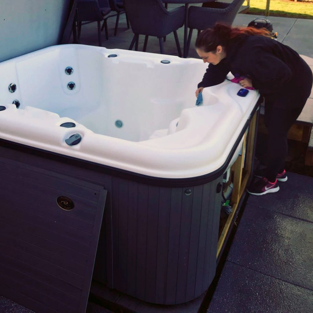 cleaning the hot tub shell