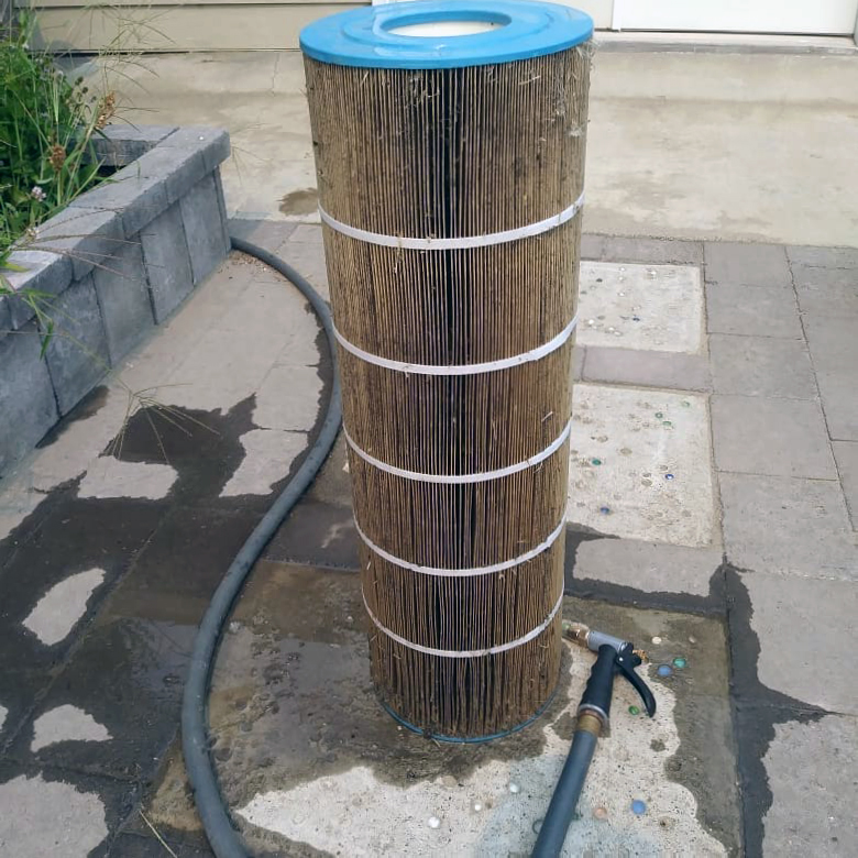 Cleaning hot tub filter media by flushing it with a garden hose