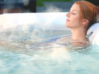 How a Hot Tub Can Help to Ease Aches & Pains
