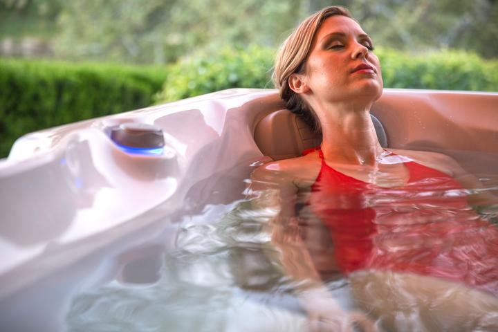 How a hot tub can help to ease pains?
